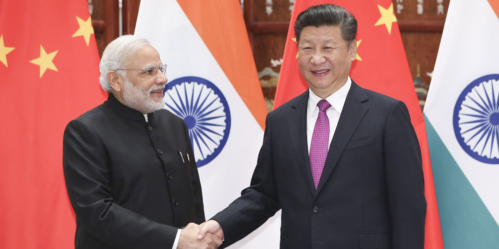China quer manter relações firmes com Índia