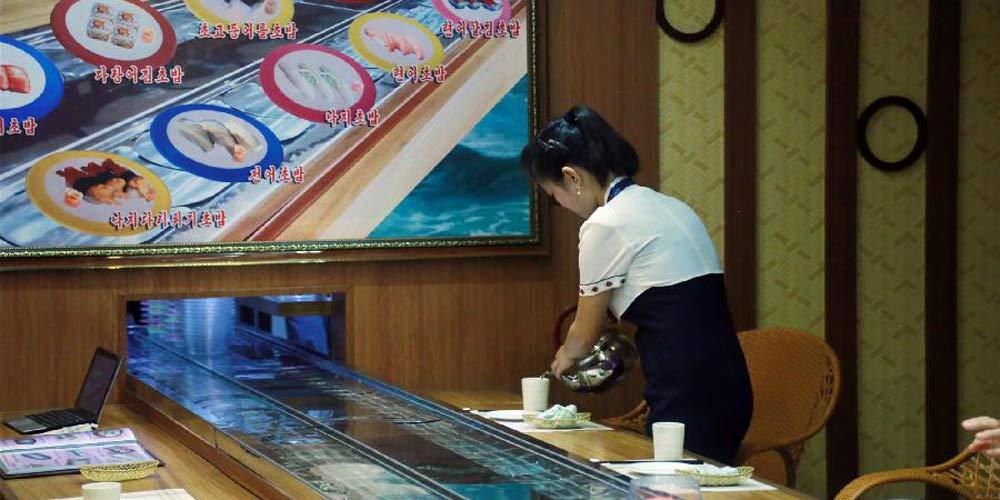 Abre o primeiro restaurante de sushi na RPDC