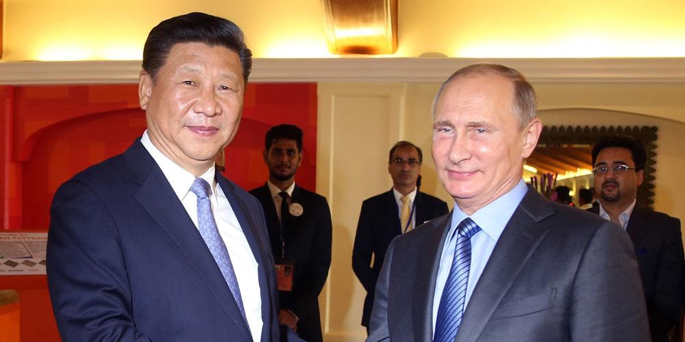 China a Rússia prometem uma cooperação aprofundada dentro de quadros multilaterais