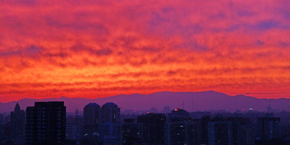 Em imagens: Incandescência do pôr do sol em Beijing