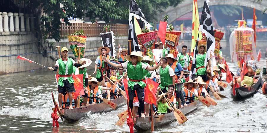 Corridas de barco saúdam chegada do Festival do Barco-Dragão em Guangzhou