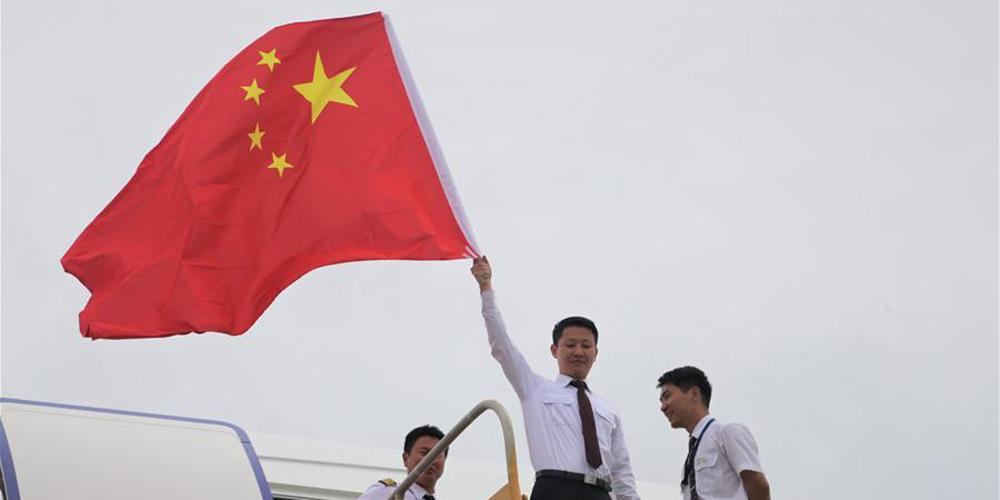 Voos fretados trazem para casa quase 400 chineses presos após passagem do furacão Maria