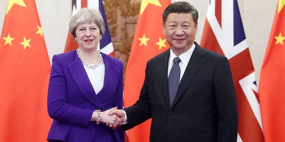 Xi se reúne com Theresa May, pedindo laços mais fortes China-Reino Unido na nova  era