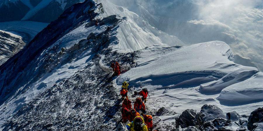 Fotos: A carreira de fotografia de Zhaxi Cering começa no topo do Monte Qomolangma