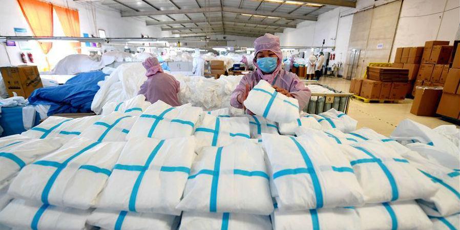 Empresas chinesas aceleram produção de suprimentos médicos para controle do coronavírus