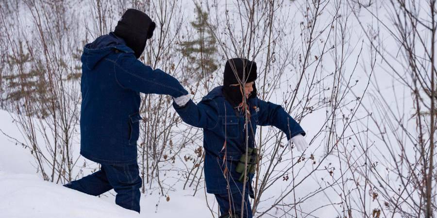 Pessoas continuam trabalhando apesar do inverno rigoroso na cidade do extremo norte da China